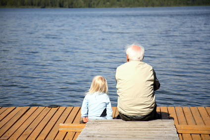 young and old by lake